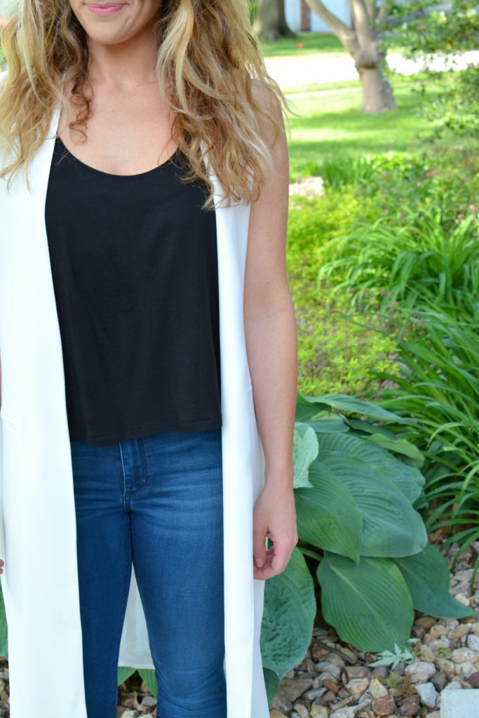 Ashley from LSR in a long white vest and black tank