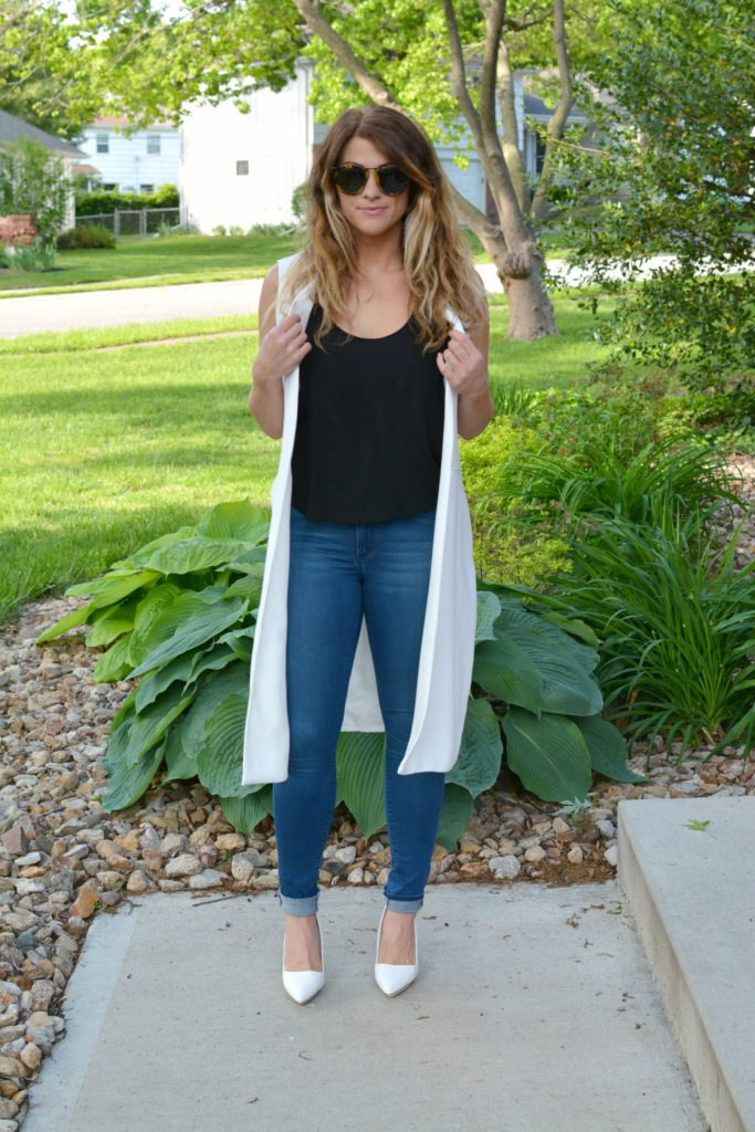 Ashley from LSR in a long white vest and white pumps
