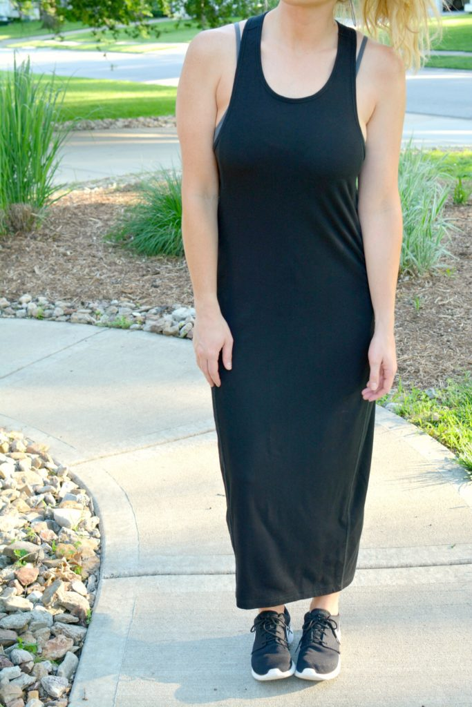 Ashley from LSR in a black ALALA dress and Nike sneakers