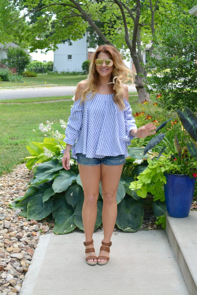 Ashley from LSR in an off-the-shoulder striped top, jean shorts, and wedges