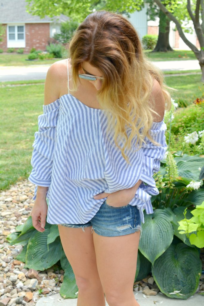 Ashley from LSR in an off-the-shoulder striped top and jean shorts