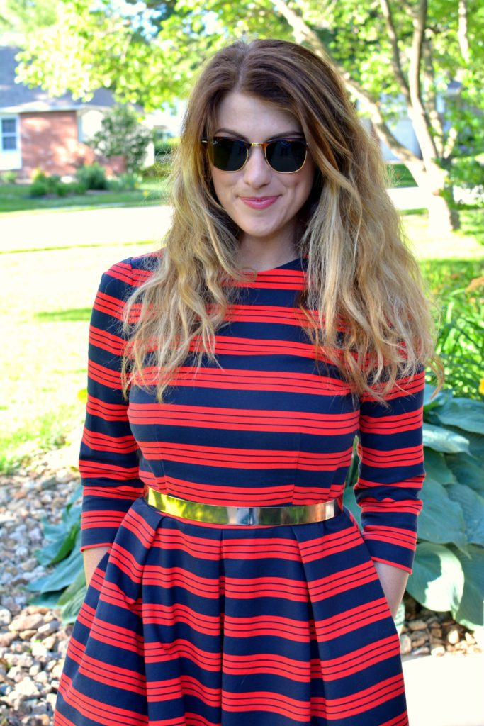 Ashley from LSR wearing a red and blue striped dress and metal belt
