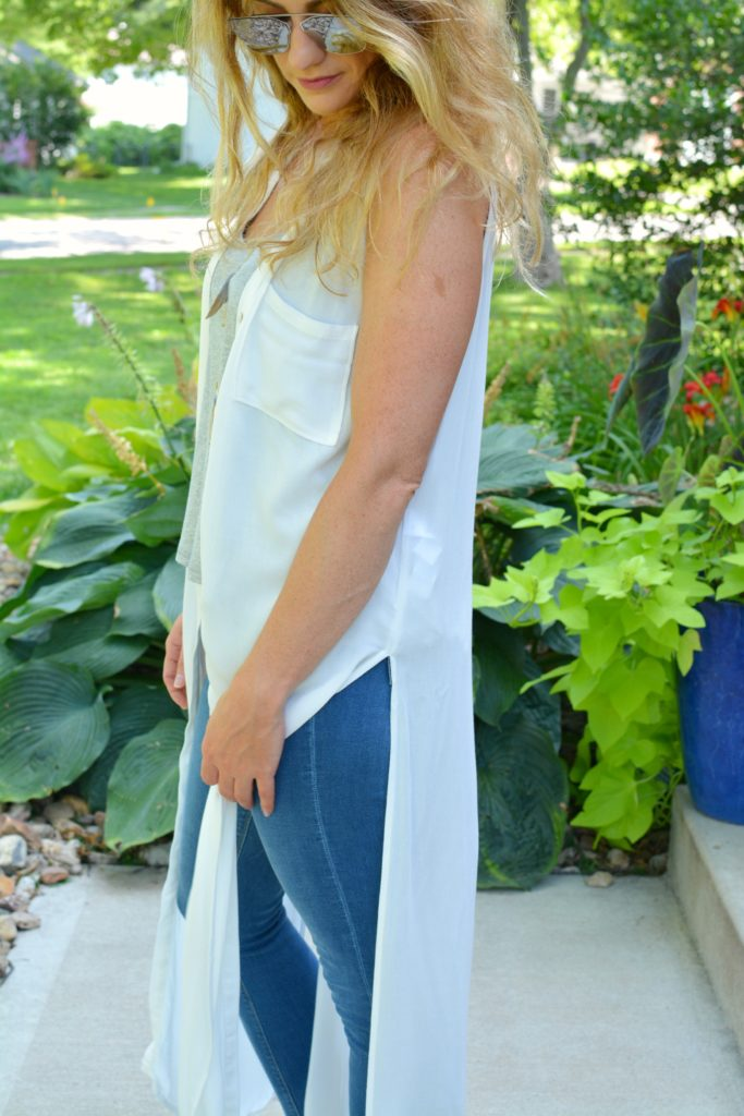 Ashley from LSR in a white duster and stepped hem jeans