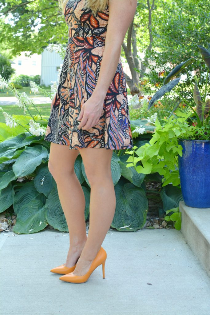 Ashley from LSR In a printed skater dress and orange pumps
