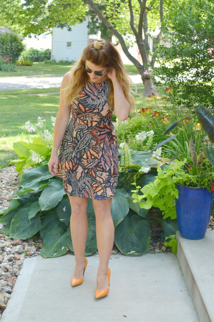 Ashley from LSR In a printed skater dress, black choker, and orange pumps