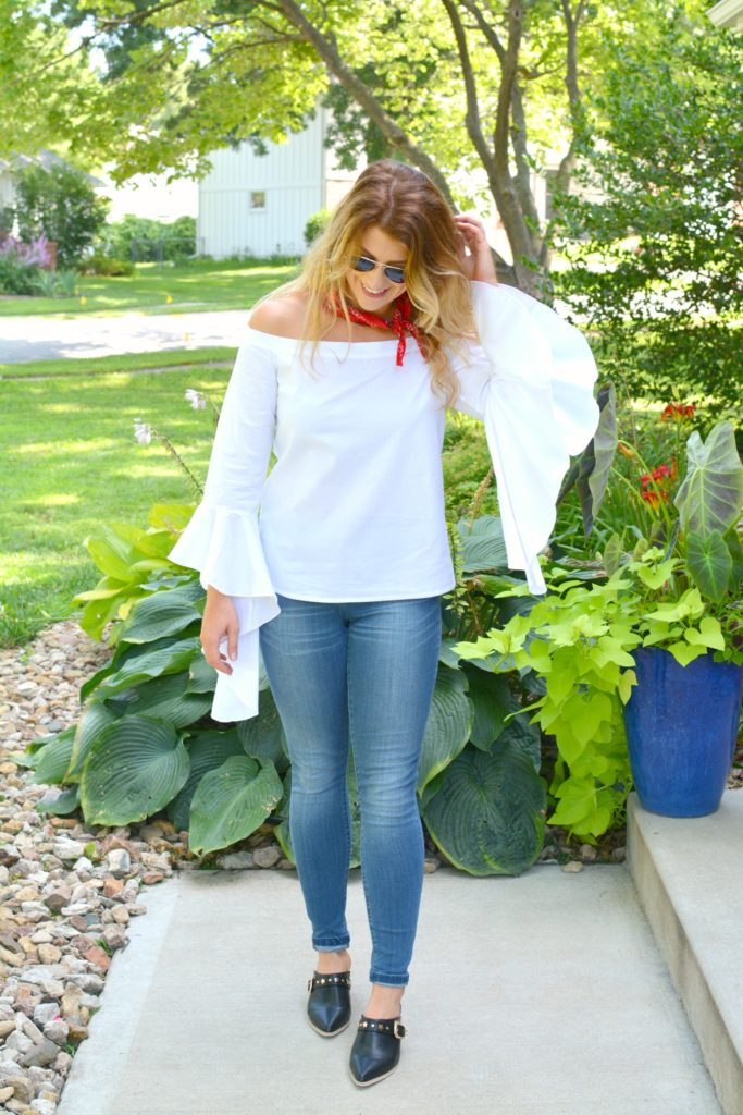 Ashley from LSR in a white off-the-shoulder statement blouse and The Limited denim, with leather mules