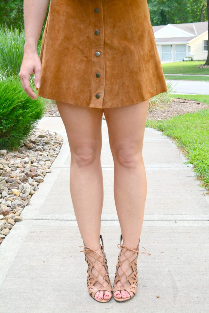 Ashley from LSR in a faux suede skirt and lace-up sandals