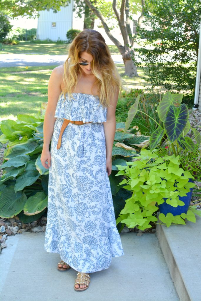Ashley from LSR in a printed linen maxi dress, linea pelle belt, and studded sandals