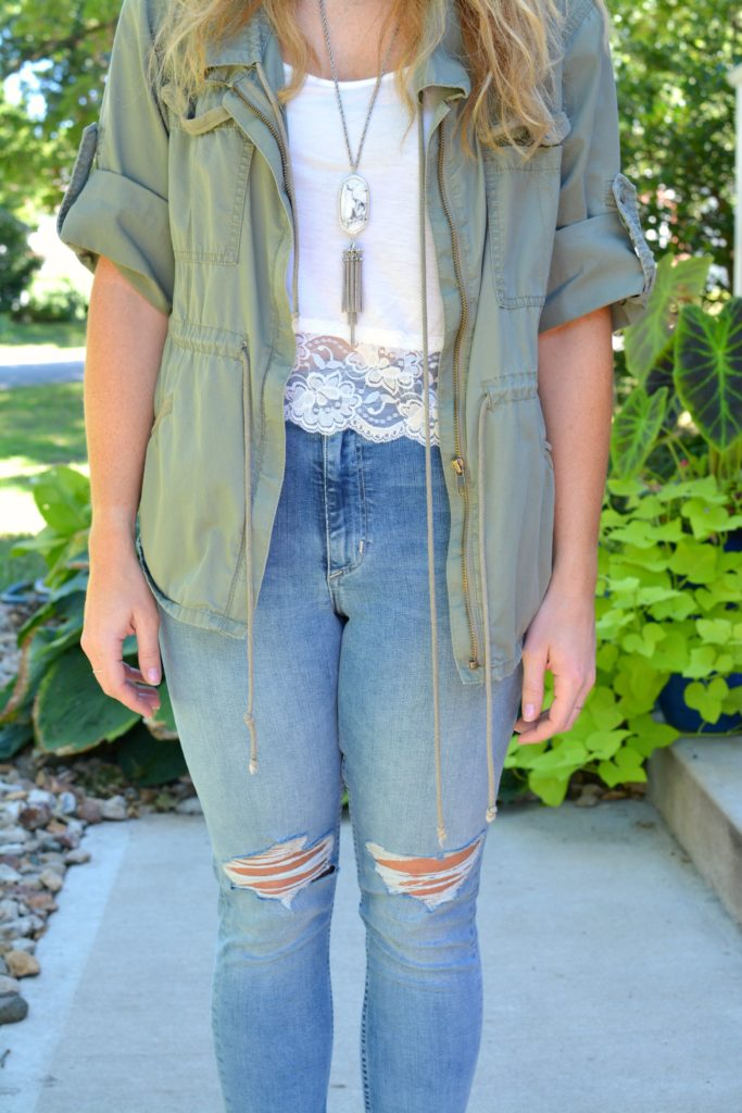 Ashley from LSR in an olive green utility jacket and destroyed denim