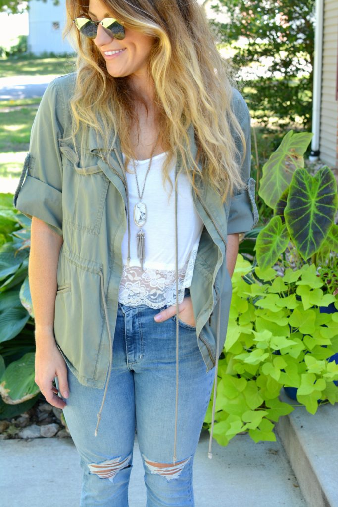 Ashley from LSR in an olive green utility jacket, destroyed denim, and Fendi sunglasses