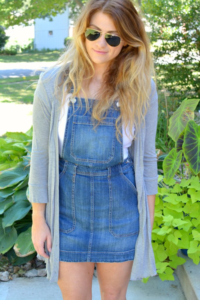 Ashley from LSR in an overall dress and gray cardigan