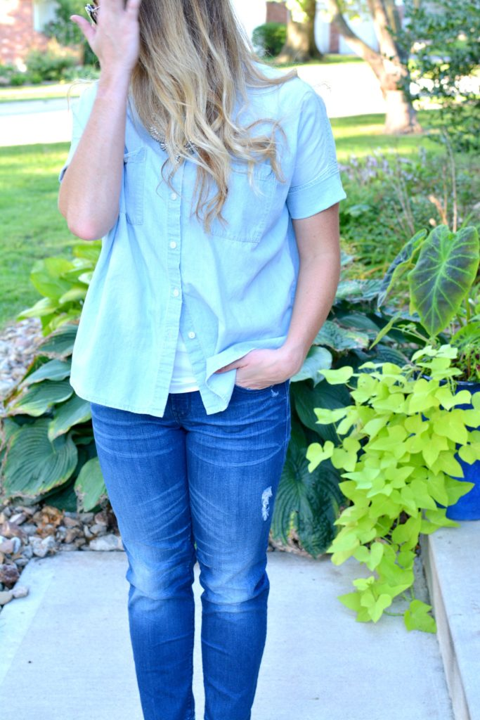 Ashley from LSR in a light chambray shirt and raw hem jeans