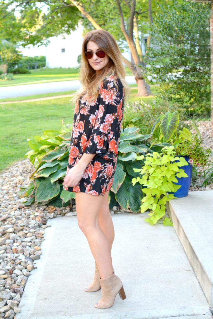 Ashley from LSR in a dark floral dress, sam edelman suede booties, and a choker set
