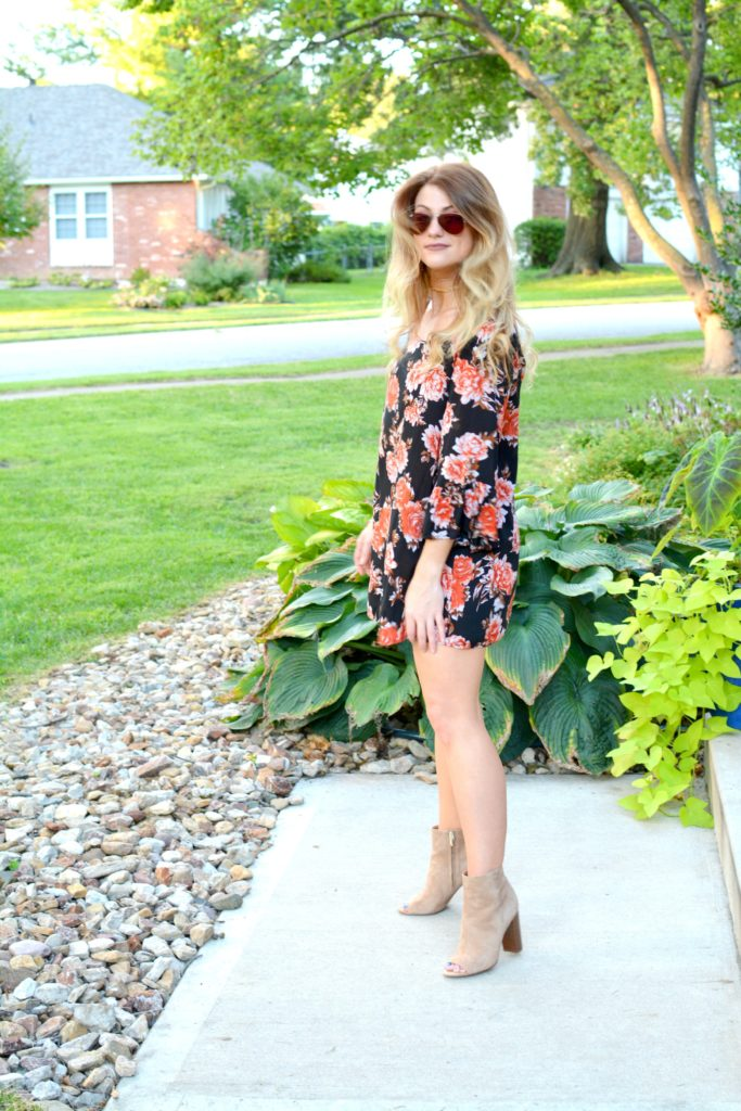 Ashley from LSR in a dark floral dress and sam edelman suede booties
