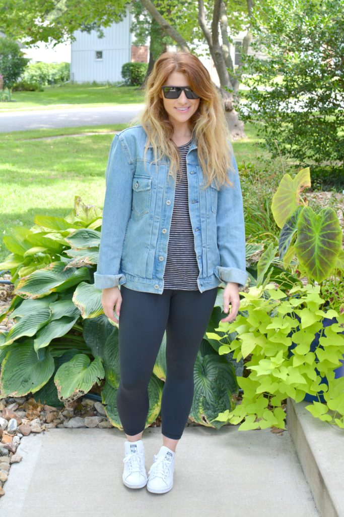 Ashley from LSR in a men's boxy denim jean jacket, striped tee, Carbon38 leggings, and Stan Smith sneakers