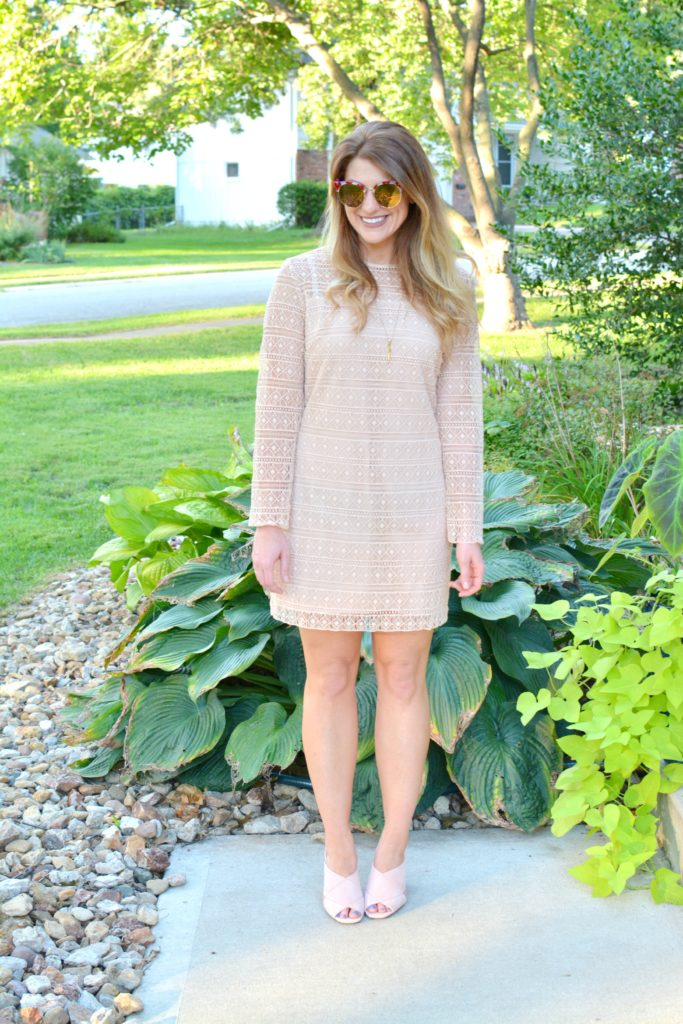 Ashley from LSR in a nude lace dress and blush suede mules