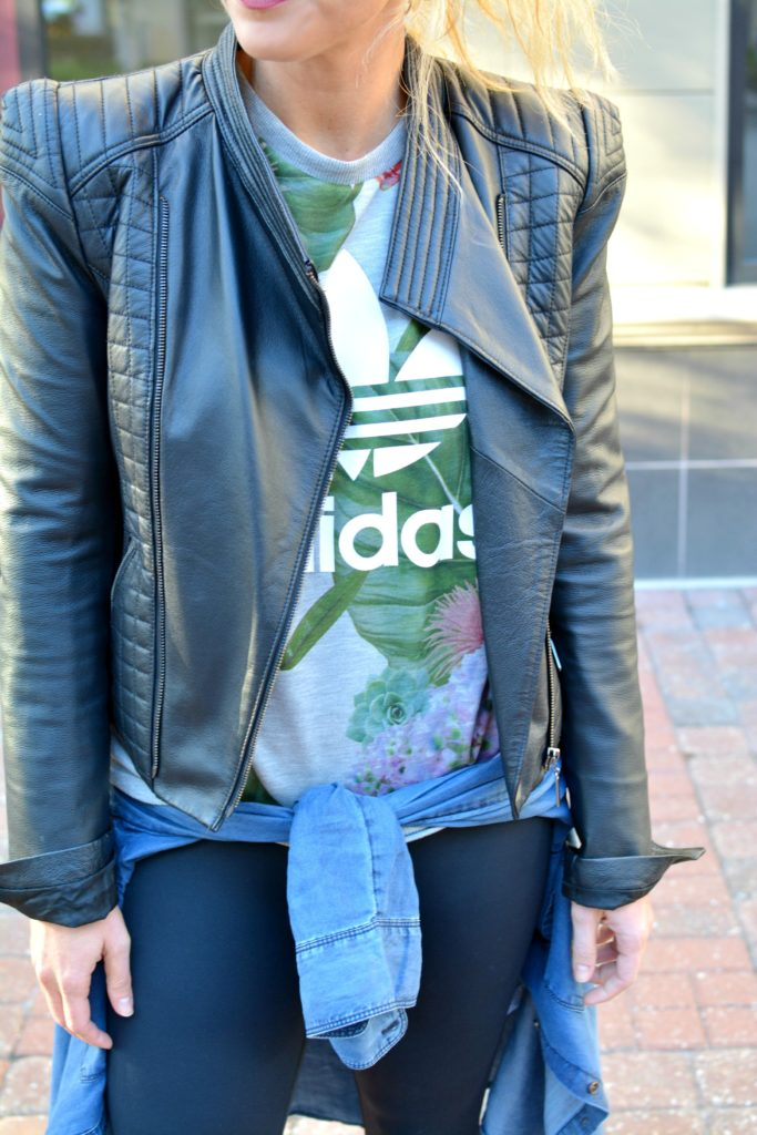 Ashley from LSR in a leather jacket and Adidas sweatshirt for an athleisure look