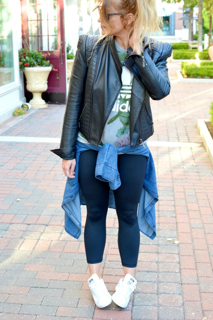 Ashley from LSR in a leather jacket, Adidas sweatshirt, leggings, and Adidas Stan Smith sneakers for an athleisure look