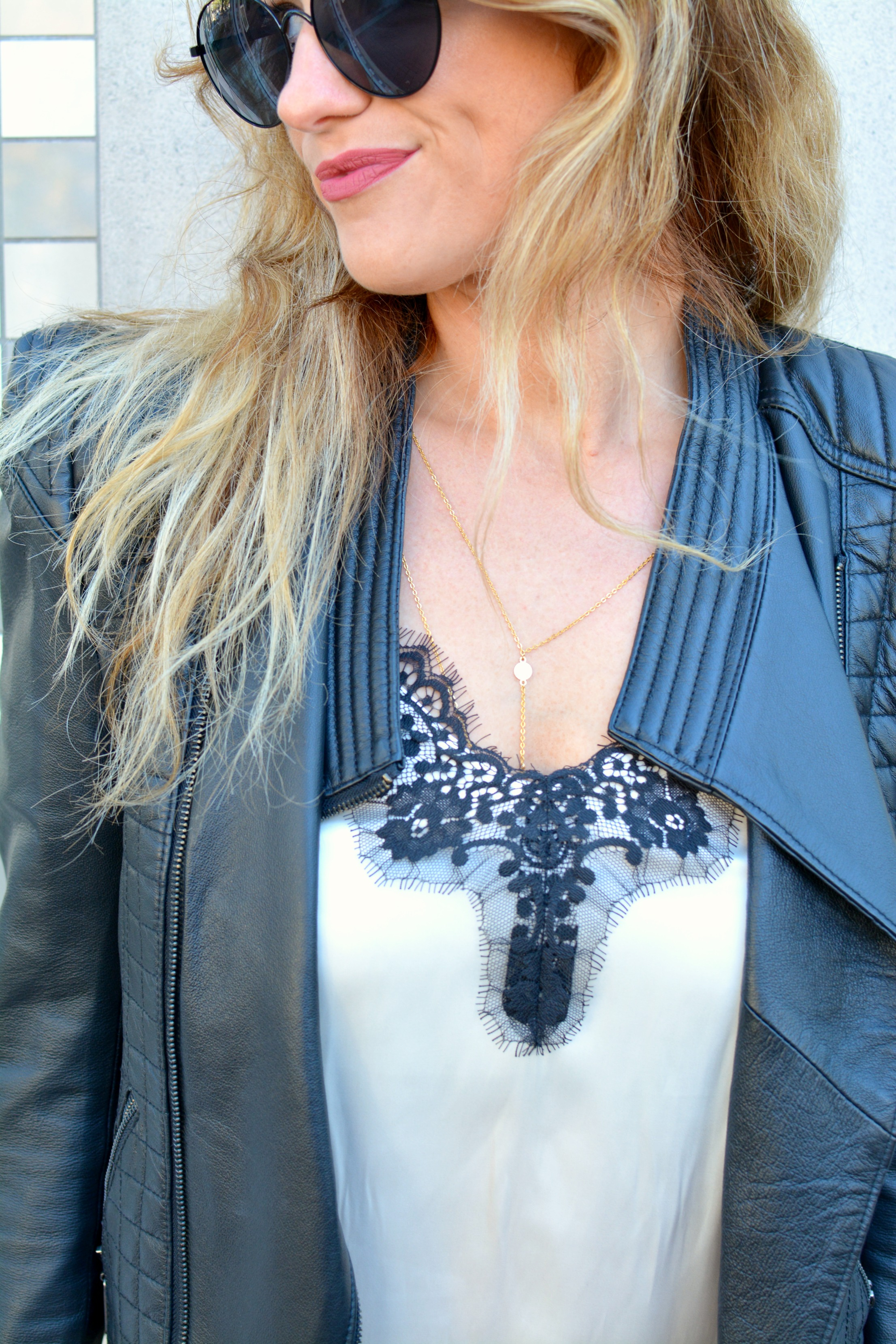 Ashley from LSR in a cream satin and black lace tank and a leather jacket