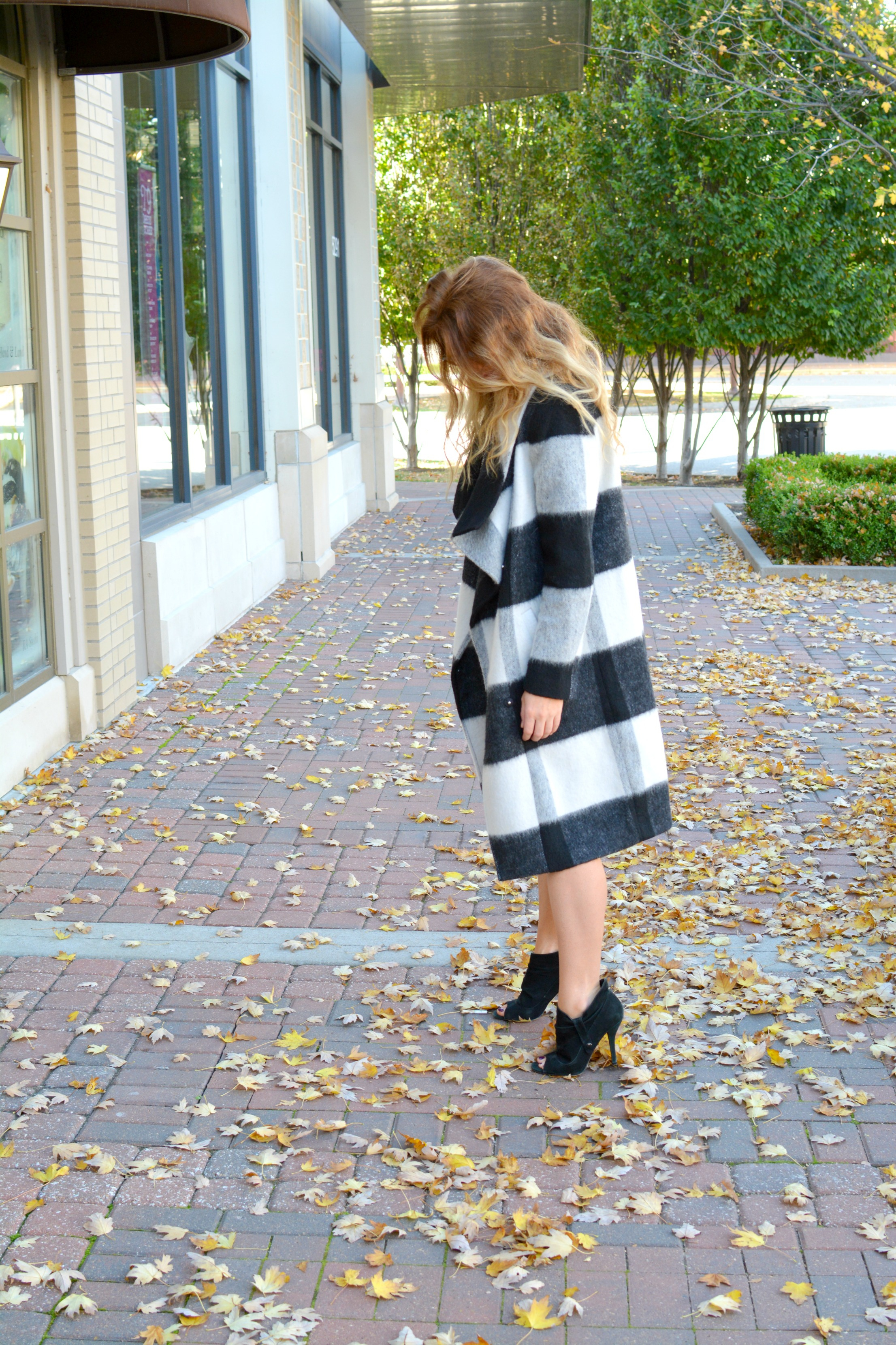 Ashley from LSR in a black and white striped coat and tweed dress