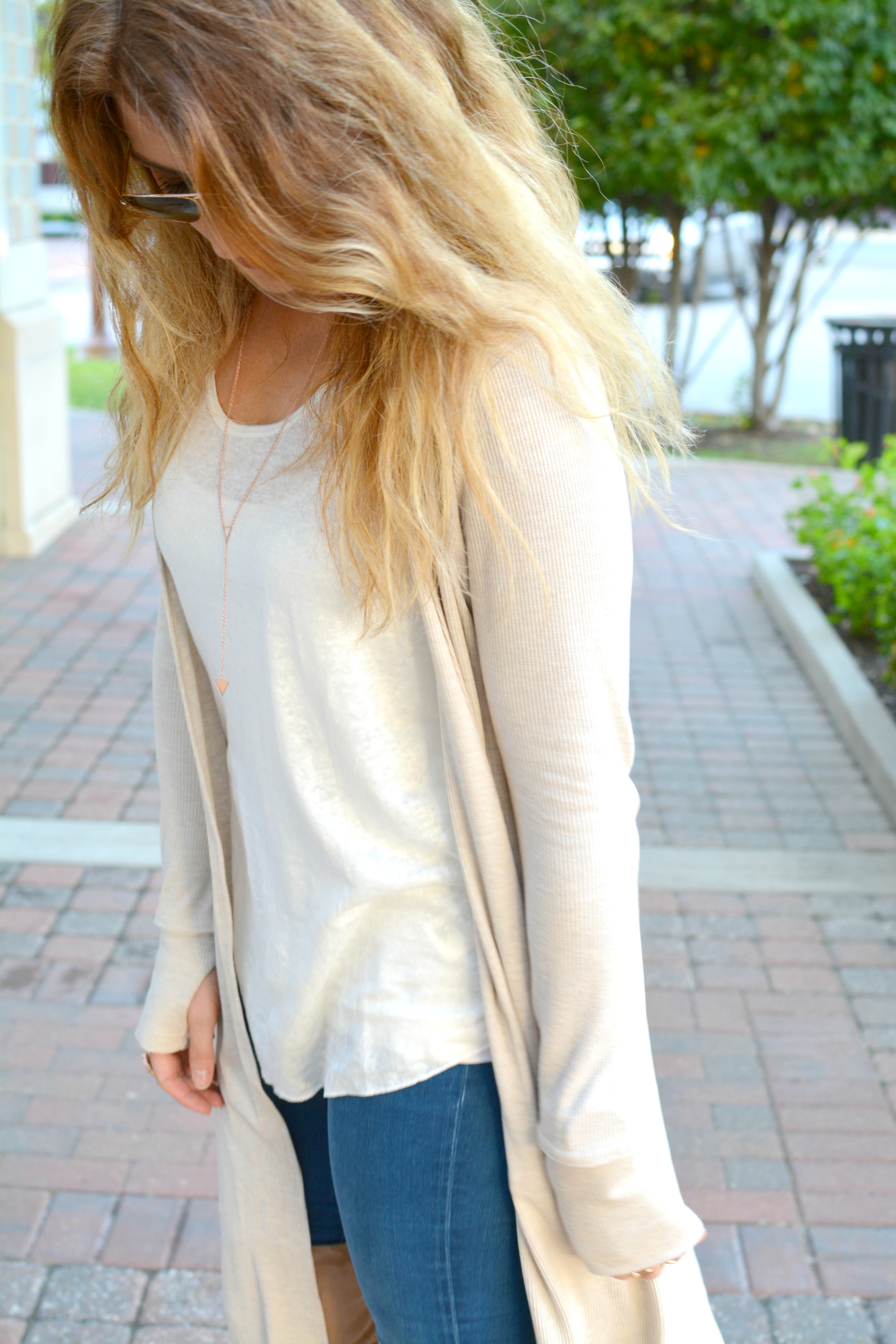 Ashley from LSR in a beige long cardigan and rose gold Gorjana necklace