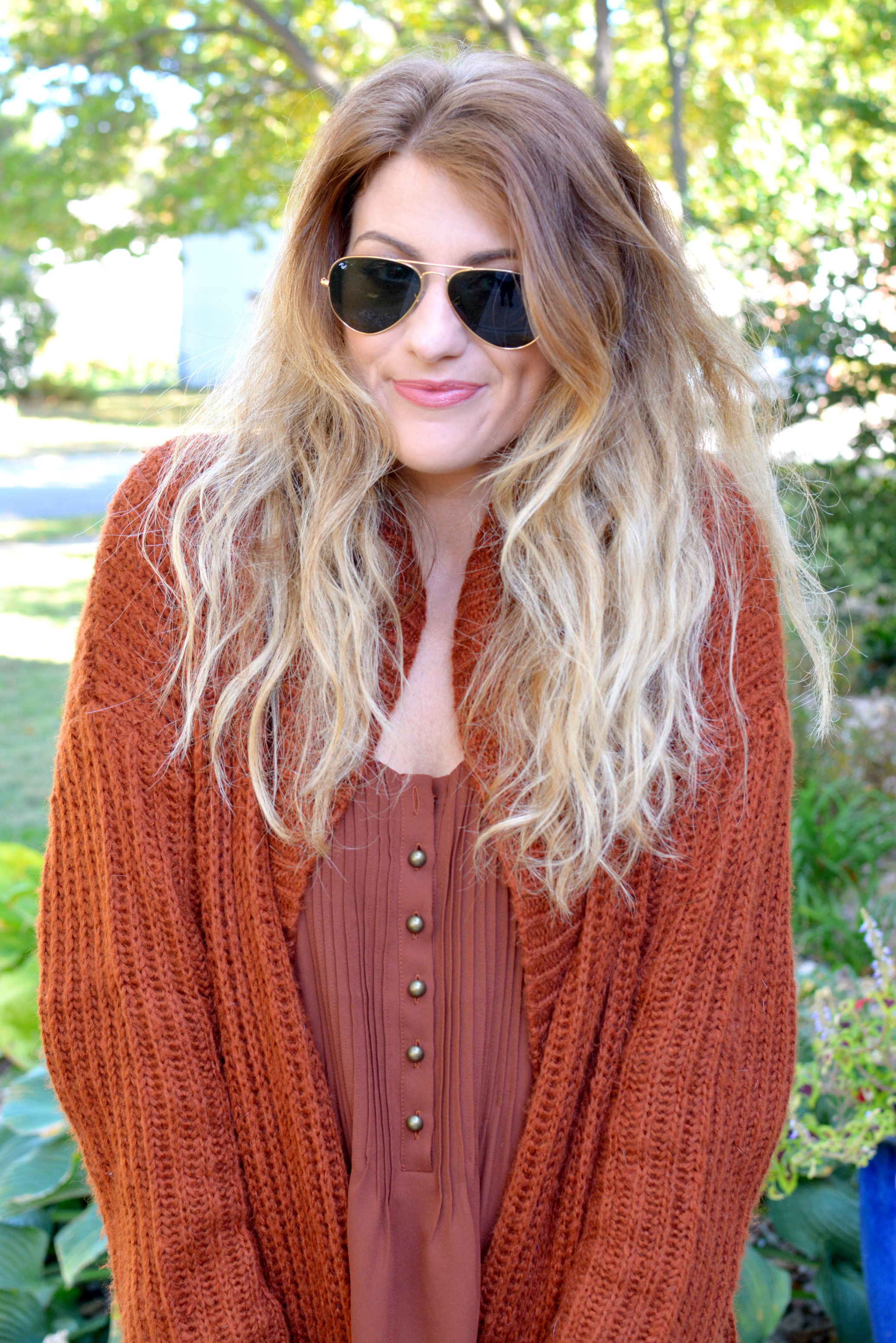 Ashley from LSR in a rust camisole and rust cardigan
