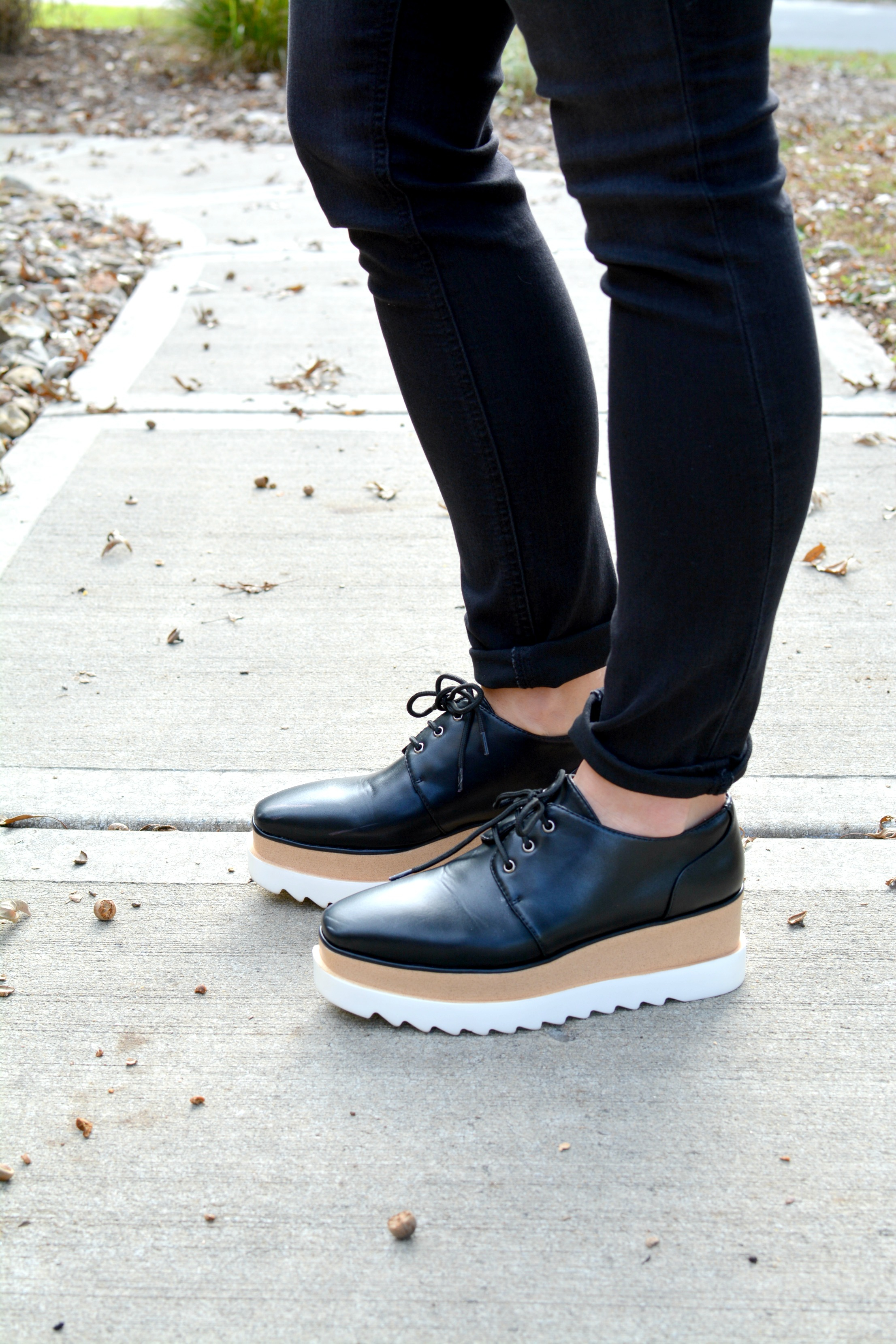 Ashley from LSR in black jeans and flatforms