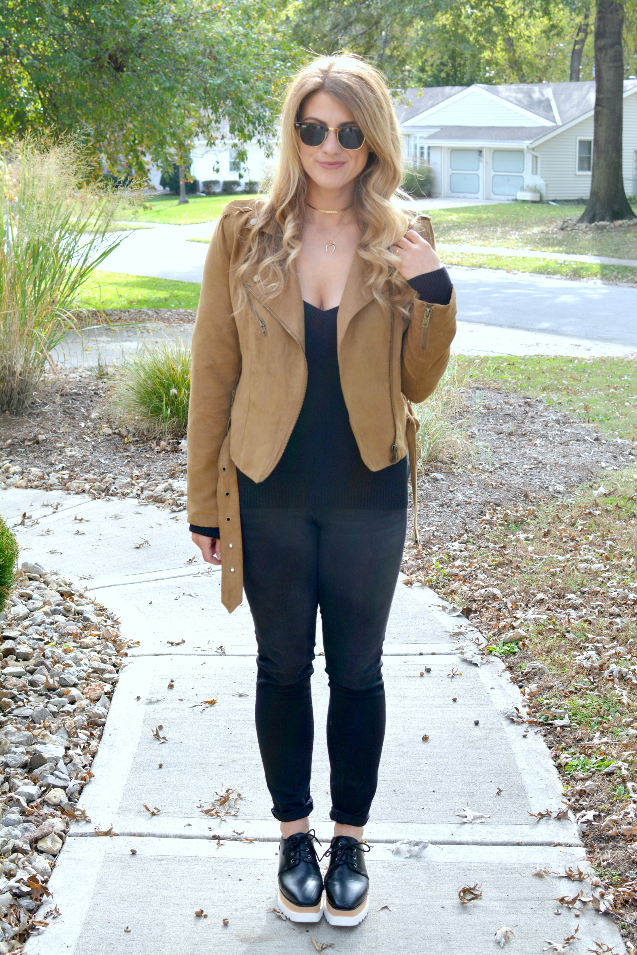 Ashley from LSR in a tan suede jacket, black jeans, and flatforms