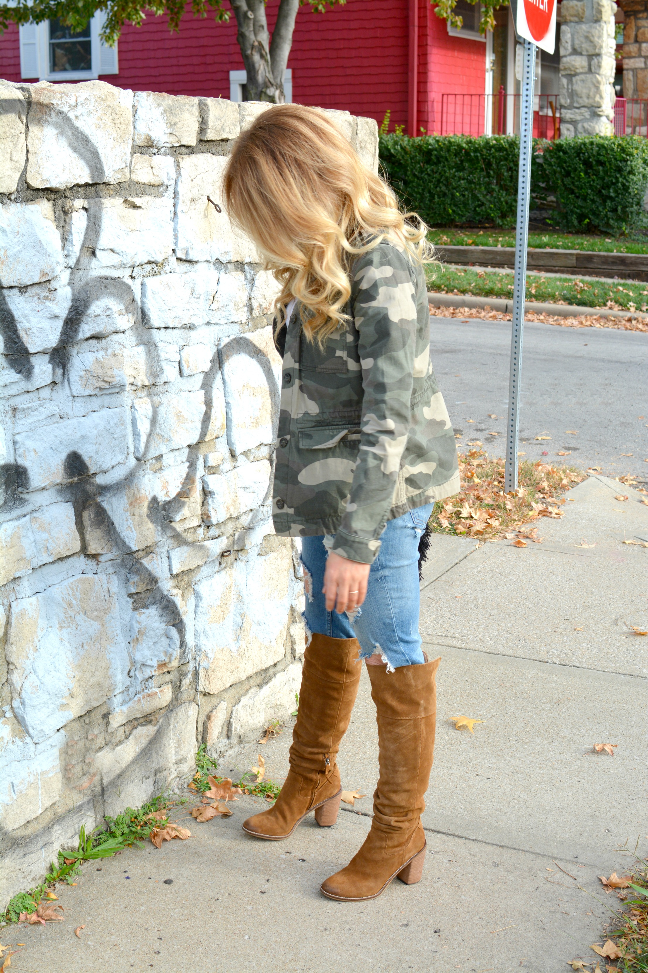 Ashley from LSR in a camo jacket and Steve Madden Palisade over the knee suede boots