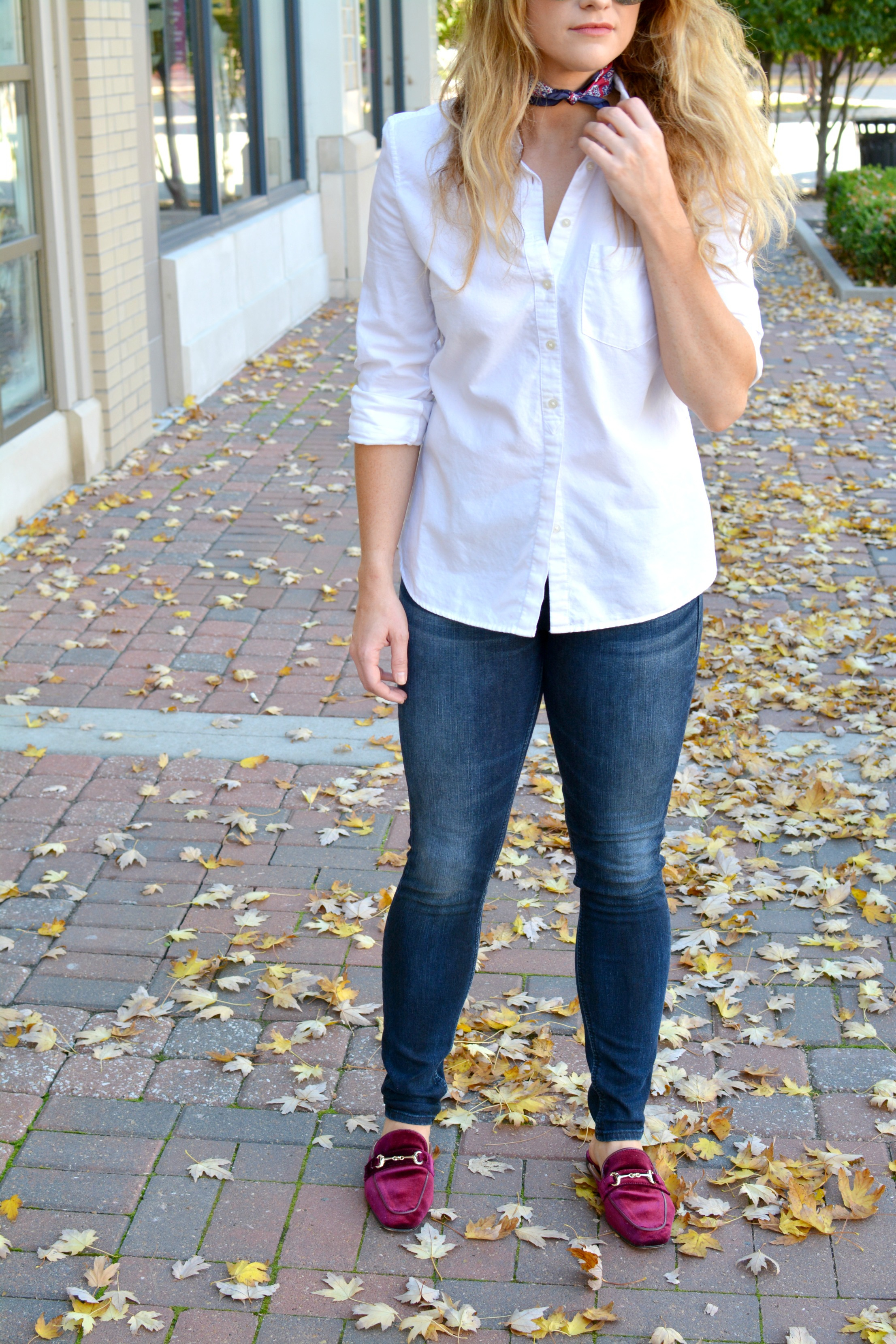 Ashley from LSR in a white boyfriend shirt, neck scarf, and burgundy velvet mules