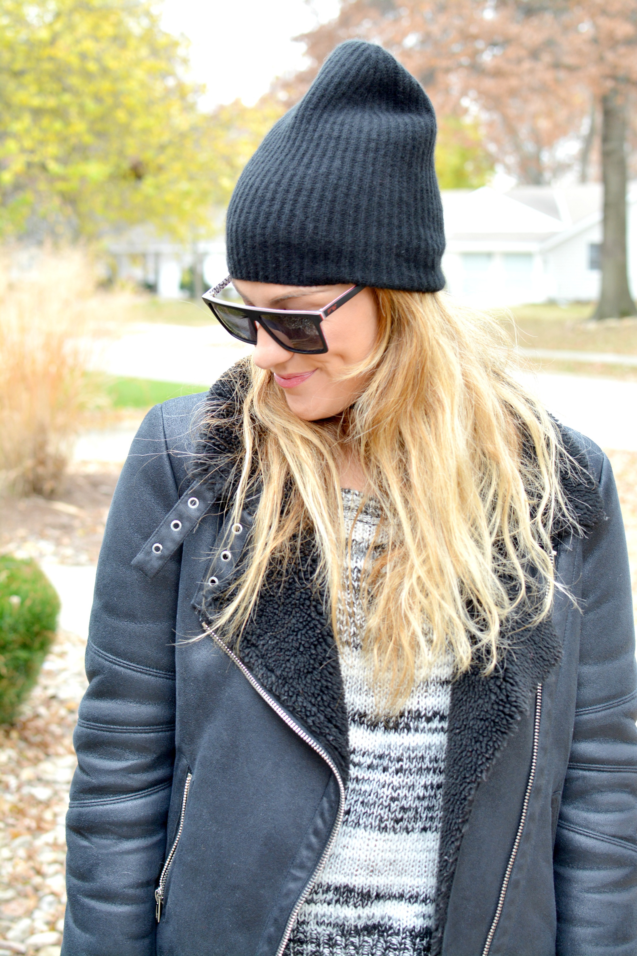 Ashley from LSR in a shearling jacket and sweater