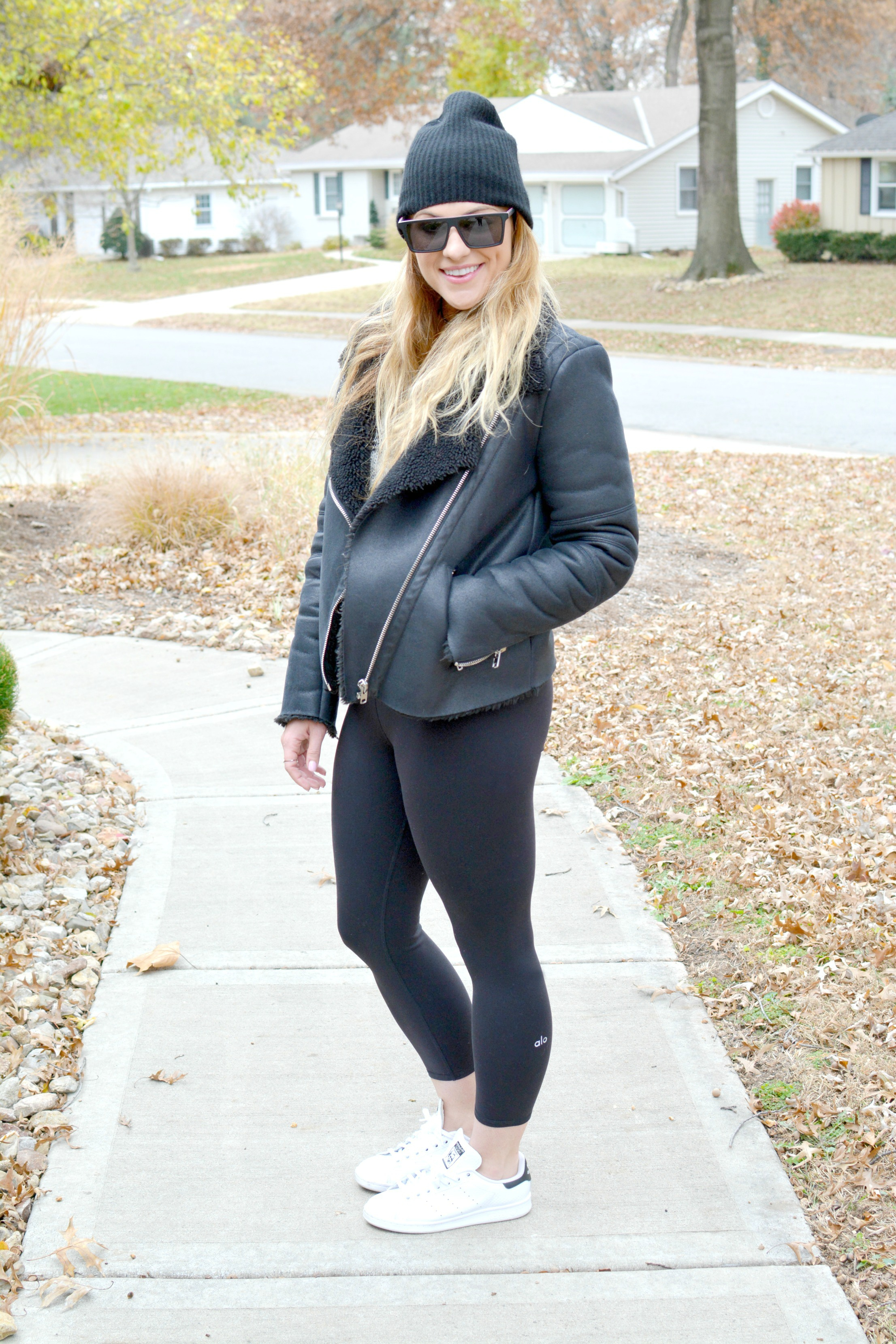 Ashley from LSR in a shearling jacket, Alo leggings, Adidas sneakers, and a beanie
