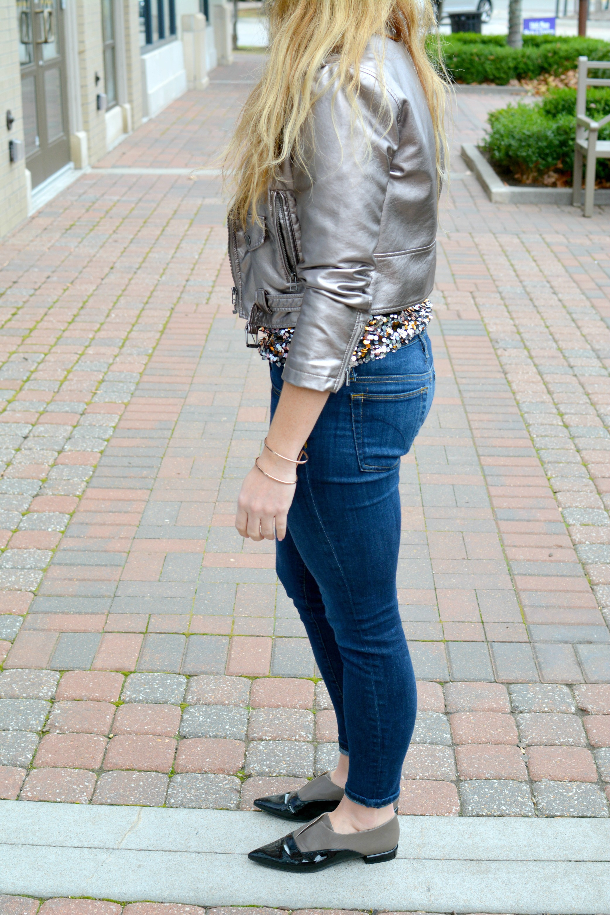 Ashley from LSR in a metallic leather jacket, sequined top, and brogues