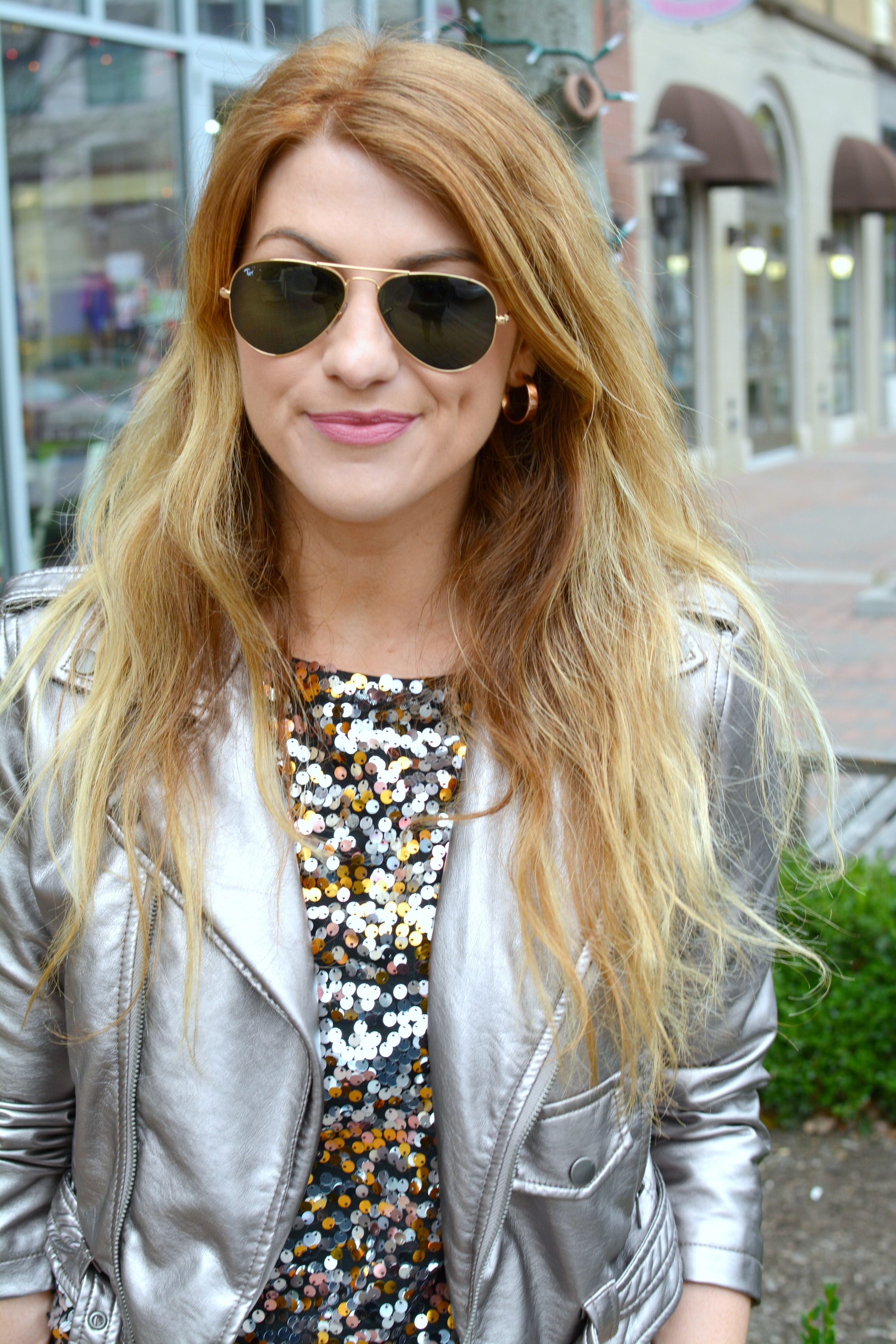 Ashley from LSR in a metallic leather jacket and a sequined top