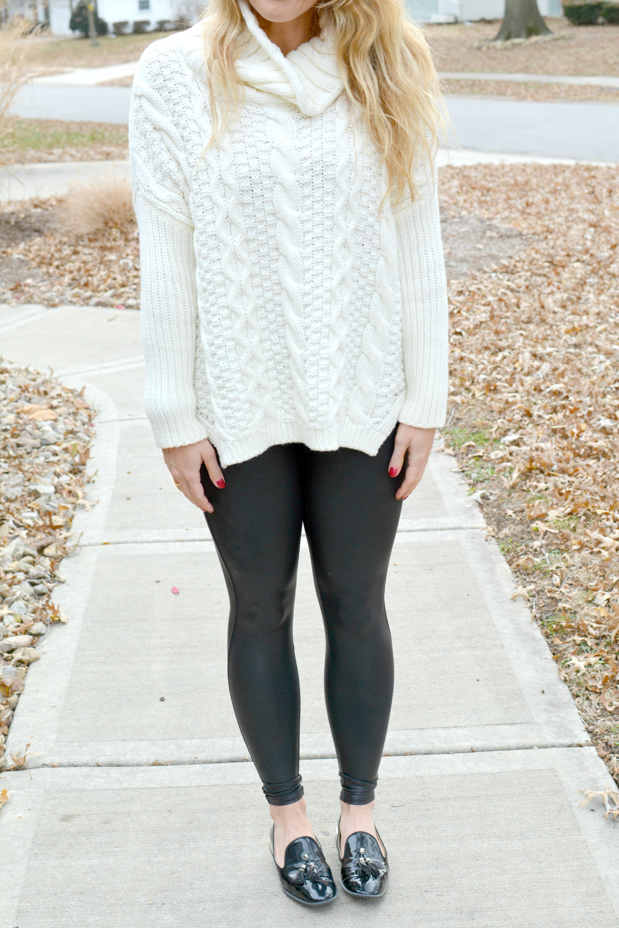 Ashley from LSR in an ivory cable knit sweater, Spanx leggings, and patent leather loafers