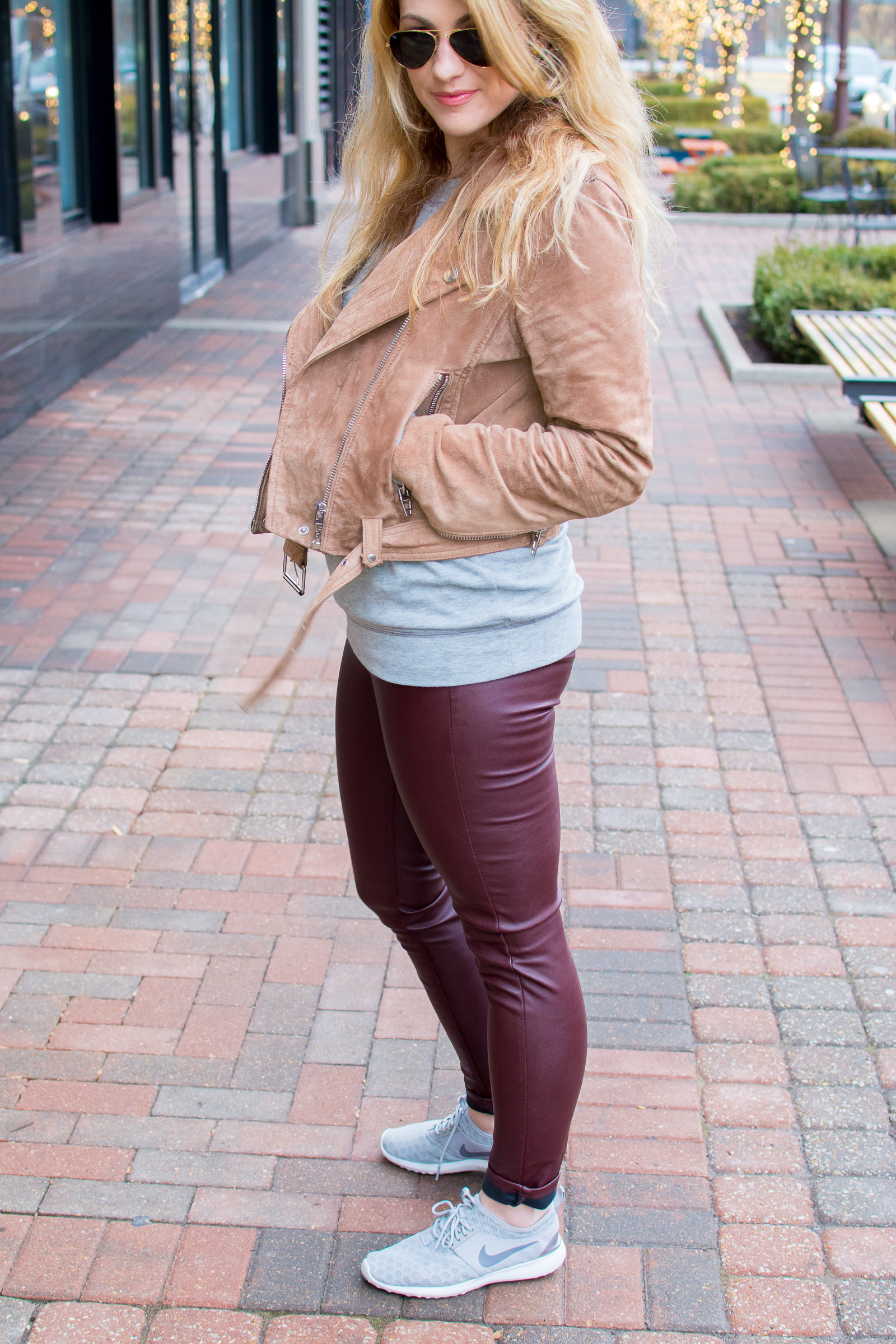 Ashley from LSR in a Blank NYC suede jacket, faux leather leggings, and sneakers