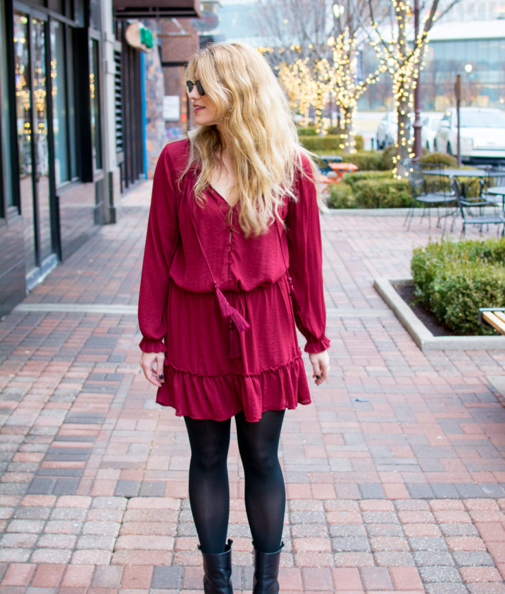 Ashley from LSR in a red dress, black tights, and black pointed toe boots