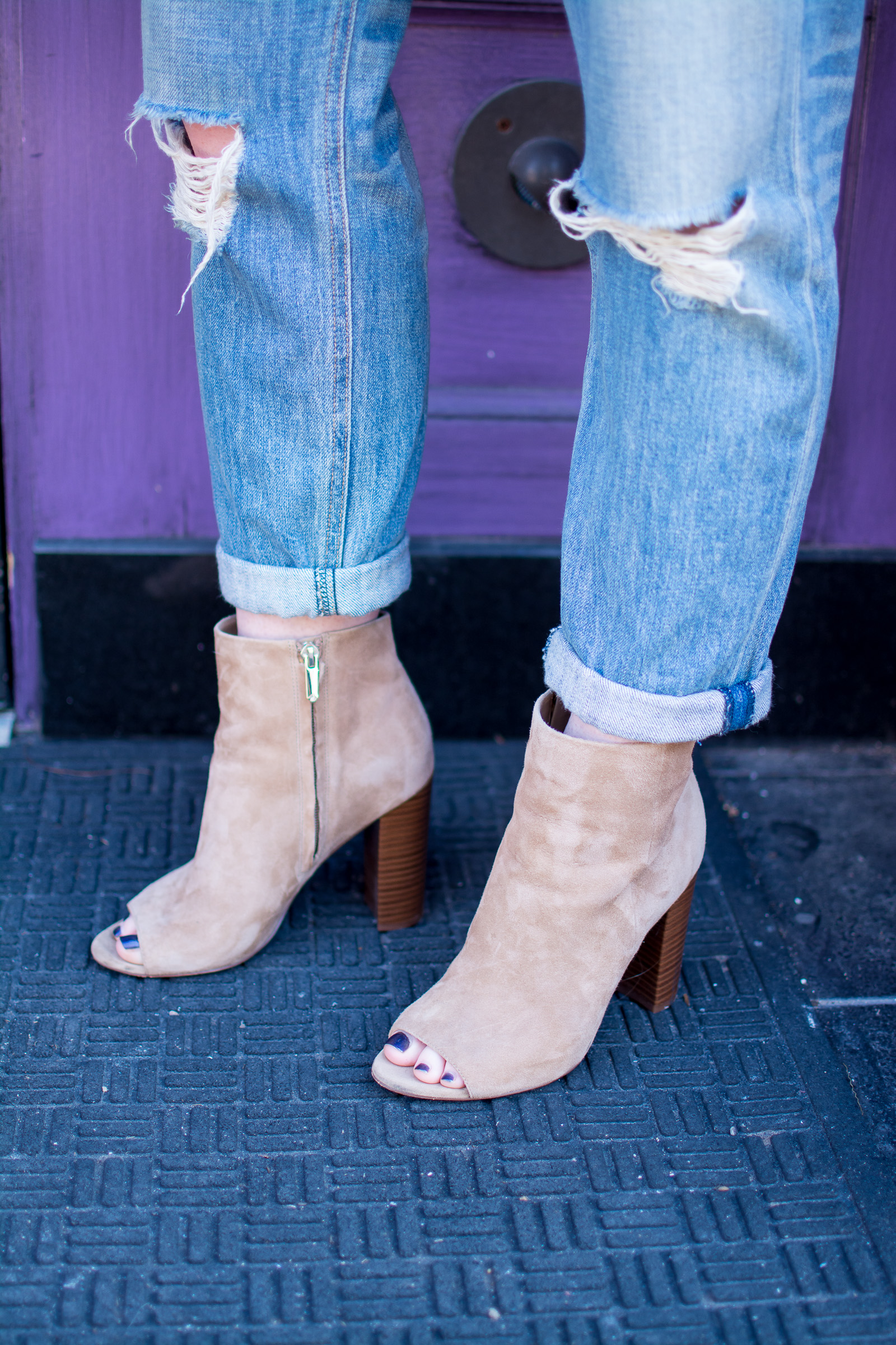 Ashley from LSR in boyfriend jeans and suede booties