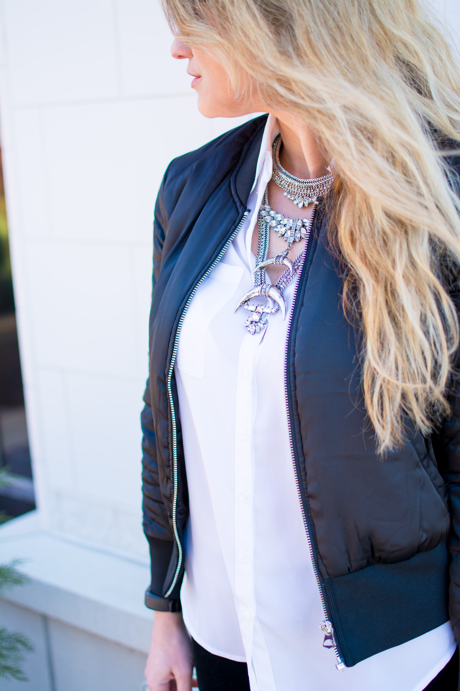 2545065a6e82 Ashley from LSR in velvet leggings, a satin bomber jacket, and a statement  necklace