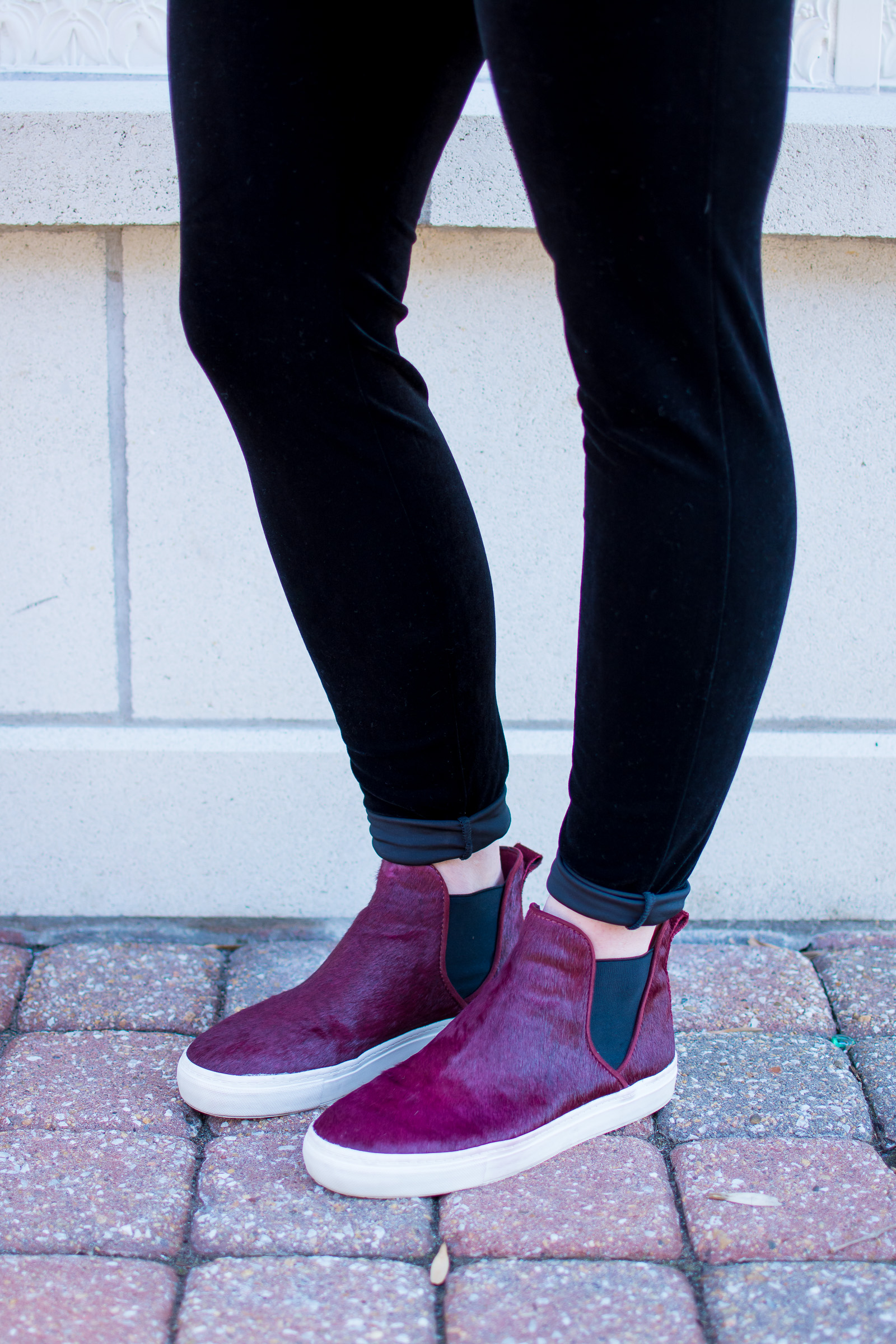 7832a78dc67e Ashley from LSR in velvet leggings and sneakers for a casual valentine's  day outfit