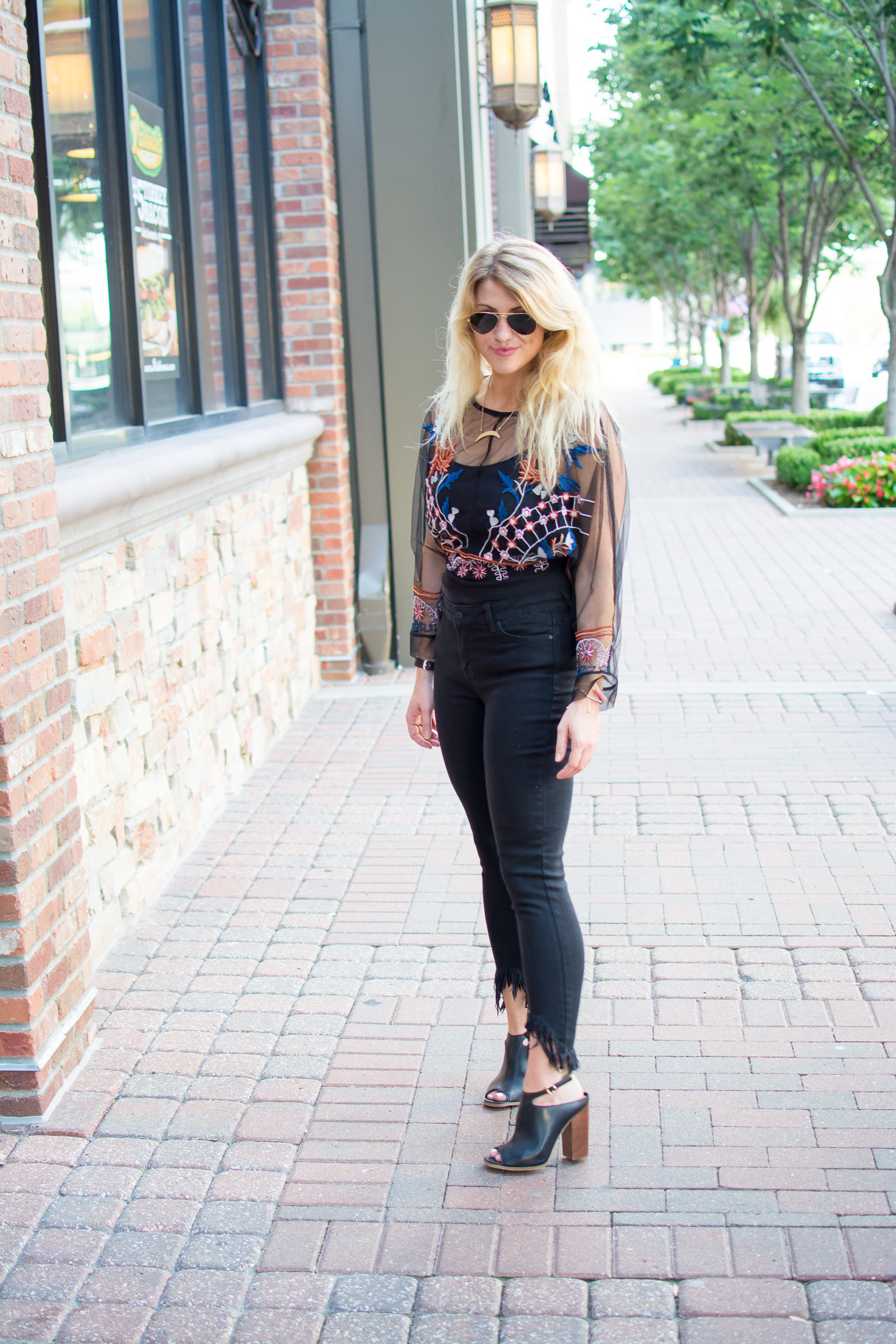 Outfit Idea: Black Frayed Jeans + Sheer Embroidered Shirt. | Ashley from Le Stylo Rouge