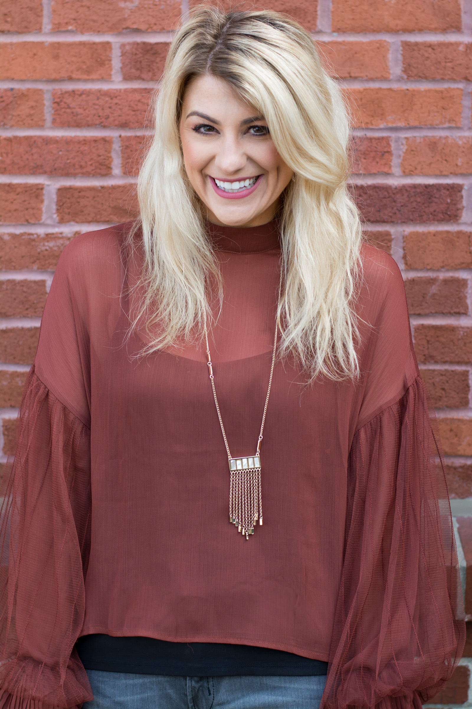 Casual Holiday Outfit: Rust Blouse + Gray Jeans. | Ashley from LSR